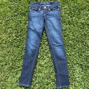 Dark wash American Eagle skinny jeans. Size 0